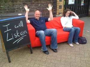 All you need is a sofa and a sign and a willingness to sit for a while until people come and talk to you!